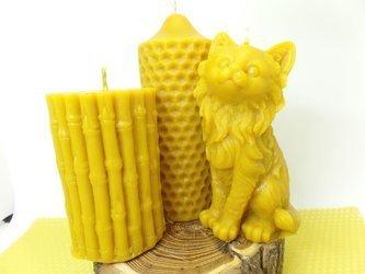 Zestaw trzech świec lanych z wosku pszczelego